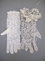 "Allison Cooke Brown, ""Gloves: Disjunction #1,"" vintage cotton woman's crochet glove attached to a hand knitted glove, 9""l x 9""h."