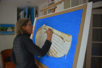 "Carol Rowan working on ""Built to Last,"" gouache on paper, 28"" x 50"""