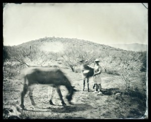 "Cole Caswell, ""Expeditionary French Man with Donkeys,"" 2013, tintype printed on newsprint, 40 x 50 in. Courtesy Susan Maasch Fine Art, Portland, ME."