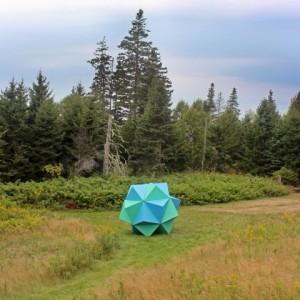 "Sean Patrick O'Brien, ""Spaceship Earth,"" 2014, oriented strand board, paint, adhesive, wire, 96 in. diameter"